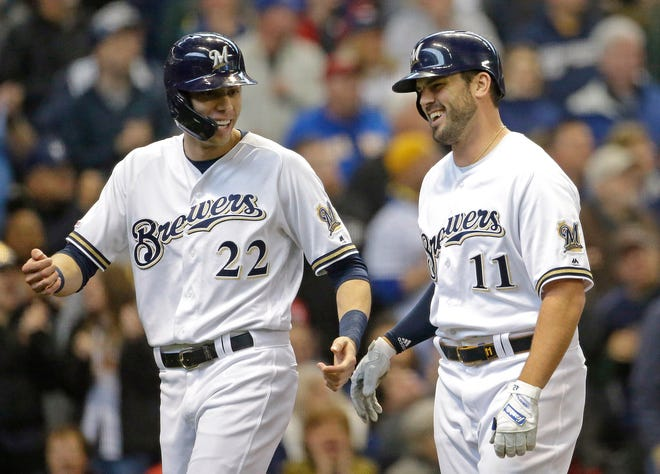 Mike Moustakas, right, celebrates with Christian Yelich after hitting a two-run home run during the second inning Wednesday.