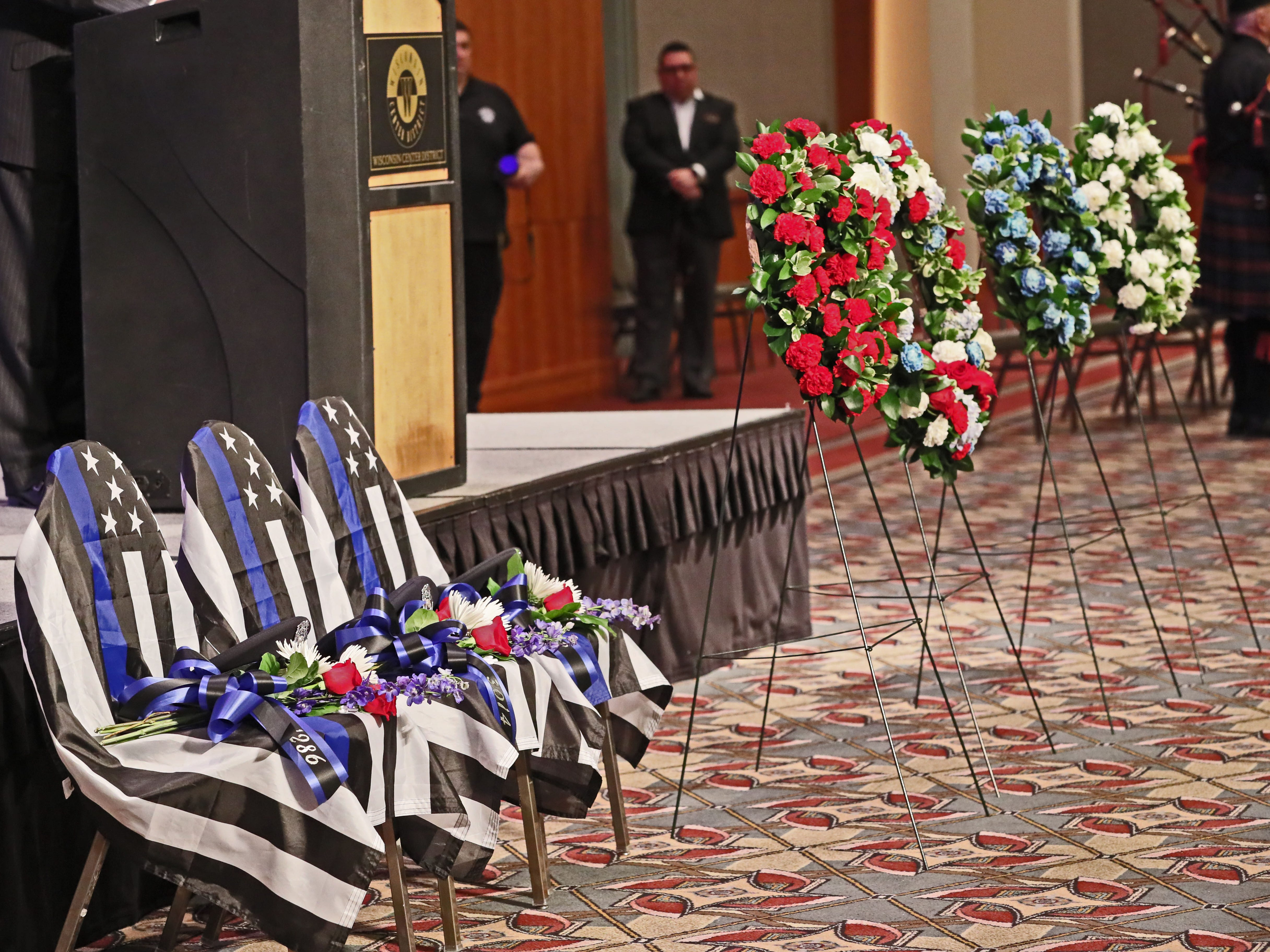 Three chairs draped with law enforcement flags memorialize three Milwaukee police officers killed in the line of duty since June 2018 at the Greater Milwaukee Law Enforcement Memorial Ceremony held at the Wisconsin Center on Wednesday.