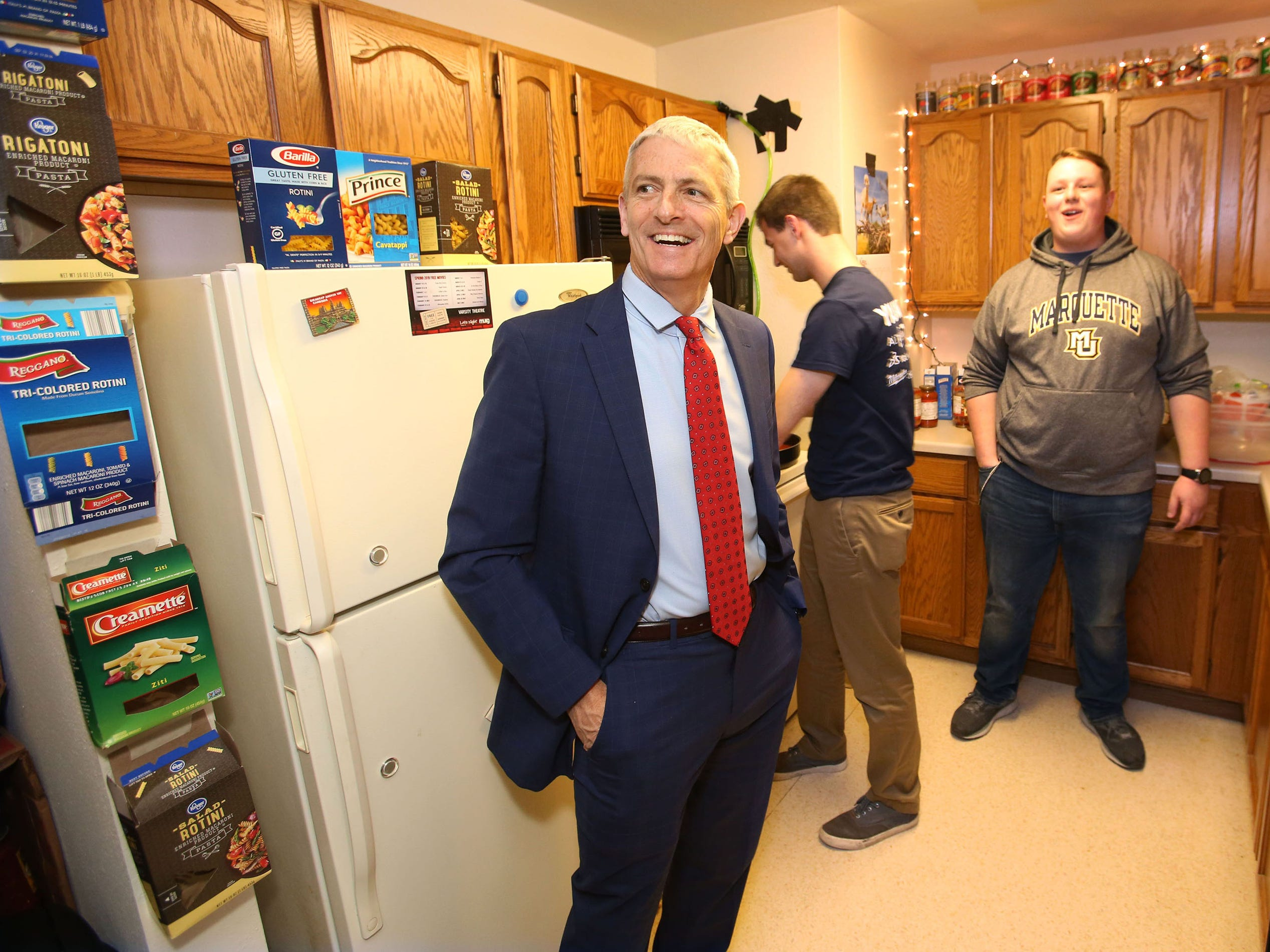 Marquette University President Michael Lovell admires the kitchen at 526 Pasta and the way it's been decorated with empty pasta boxes and sauce cans.