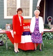 Cathy Zeuske with her grandmother Ethel on the 75th anniversary of women's suffrage outside the Oshkosh home of suffragist Jessie Jack Hooper.