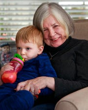 "Genevieve McBride, author of ""On Wisconsin Women: Working for Their Rights from Settlement to Suffrage,""  spends time with her grandson Dawson John O'Connell at her Pewaukee home."