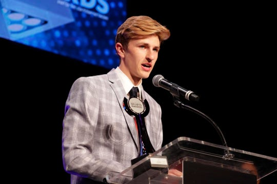 Drew Bosley speaks after being named the boys cross-county athlete of the year at the Journal Sentinel High School Sports Awards on Tuesday at the Pabst Theater. Bosley, who also stars in track, was later named the boys area athlete of the year.