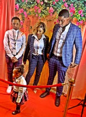 Sieria Payne with her son, Kirtrell Jordan; daughter, Syi Monroe; and husband, Lenard Monroe.