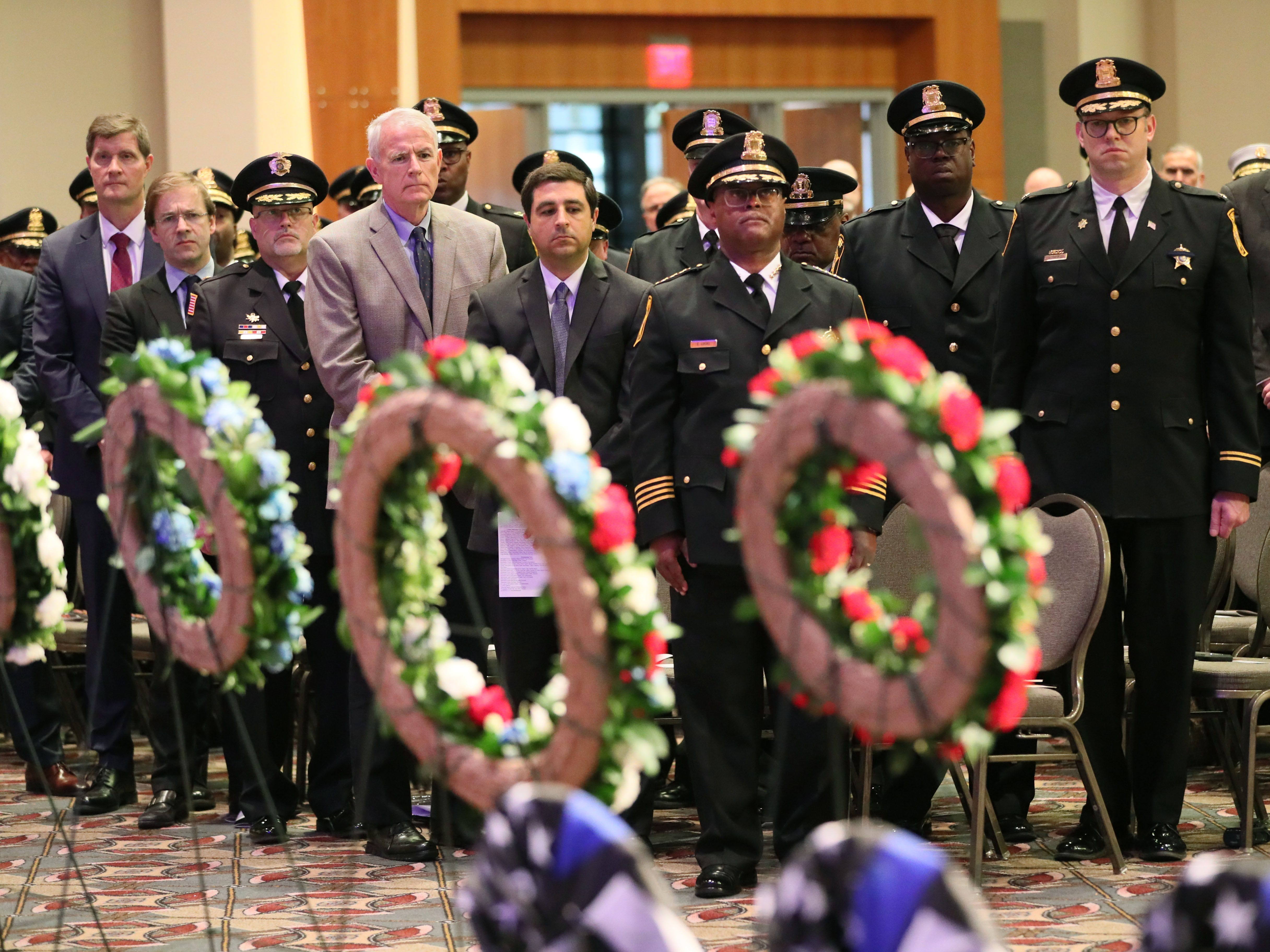 Law enforcement and elected officials stand during the Greater Milwaukee Law Enforcement Memorial Ceremony held at the Wisconsin Center on Wednesday.