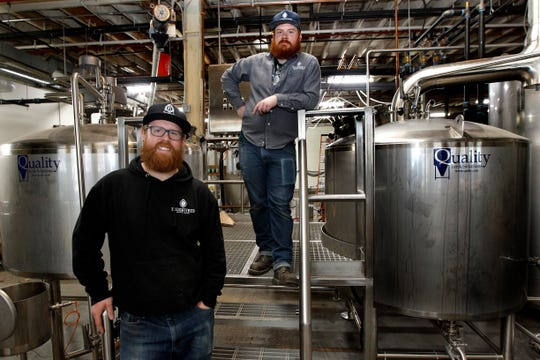 Tommy Vandervort, left, and James Larson open their third version of  Enlightened Brewing on Saturday. The brewery grew out of its cozy Lincoln Warehouse site.