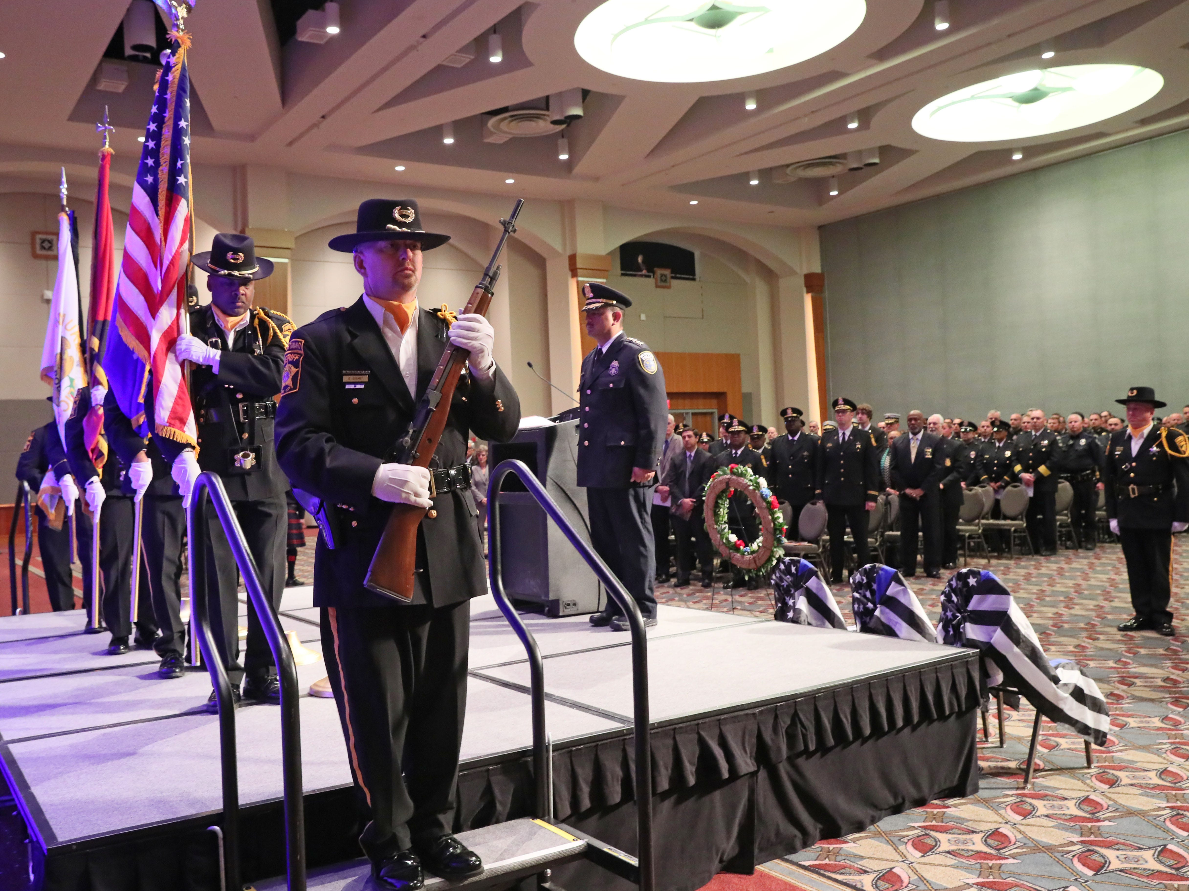 Members of the Combined Honor Guards of Milwaukee County Law Enforcement present the colors to start the service.
