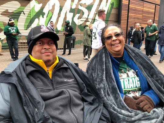 Avery and Sherelle Harris of Milwaukee staked out the equivalent of mid-court seats and set up their polka-dot camping chairs in front of the 28-foot screen at the Beer Garden outside Fiserv Forum on Wednesday.