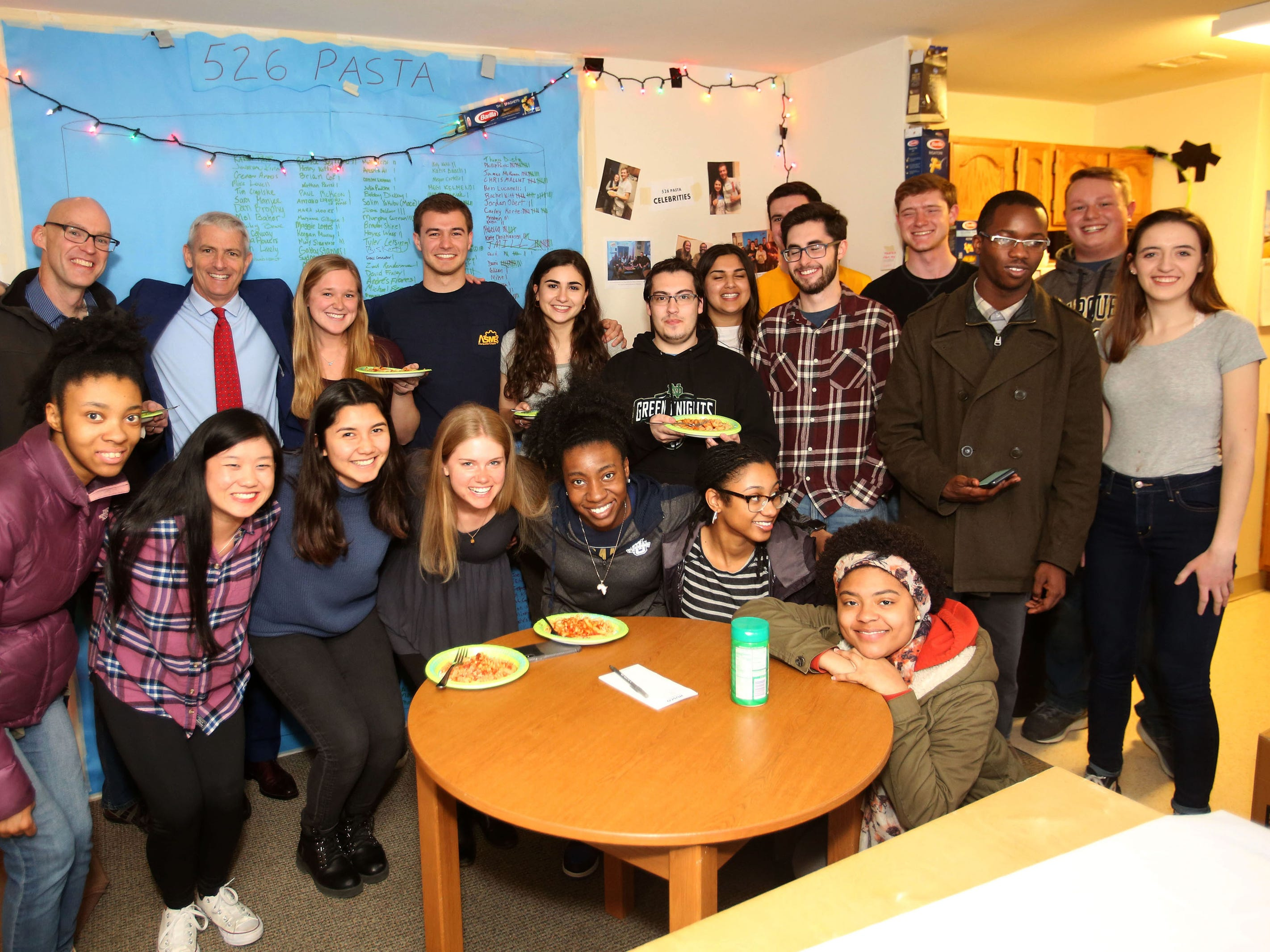 It's not unusual for dozens of Marquette University students and faculty to crowd into the two-bedroom apartment of engineering majors who started a Friday night tradition called 526 Pasta. The goal was to meet 526 new people during senior year by serving up free pasta. Why 526? It's their apartment number.