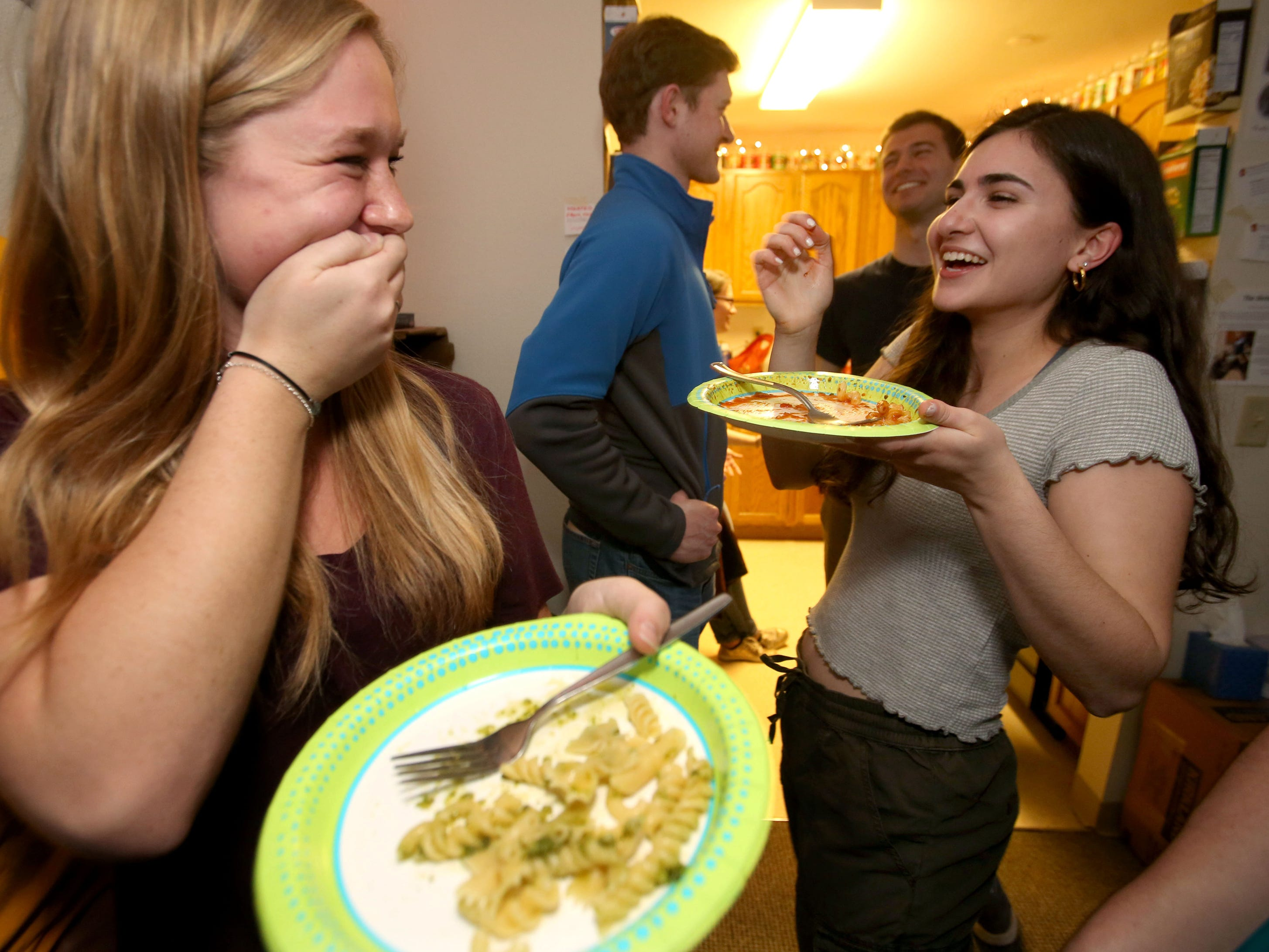 Marquette students Carley Korte, left, a junior in mechanical engineering, and Lia Grandinetti, a junior in arts and sciences, share a laugh while dining at 526 Pasta.