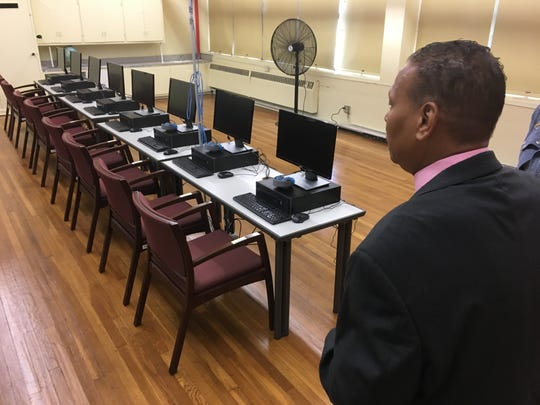 Youth Employment Service Executive Director Cederick Williams talks about the program's donated computers.