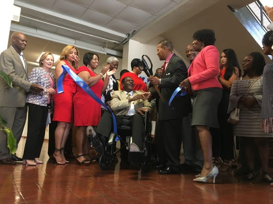 Donors and supporters cheer the opening of Youth Employment Service during a Wednesday ribbon cutting event.