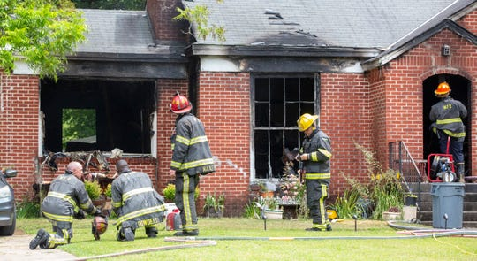 Five people were injured in a house fire on South Perry Street. Two of the five suffered life-threatening injuries.