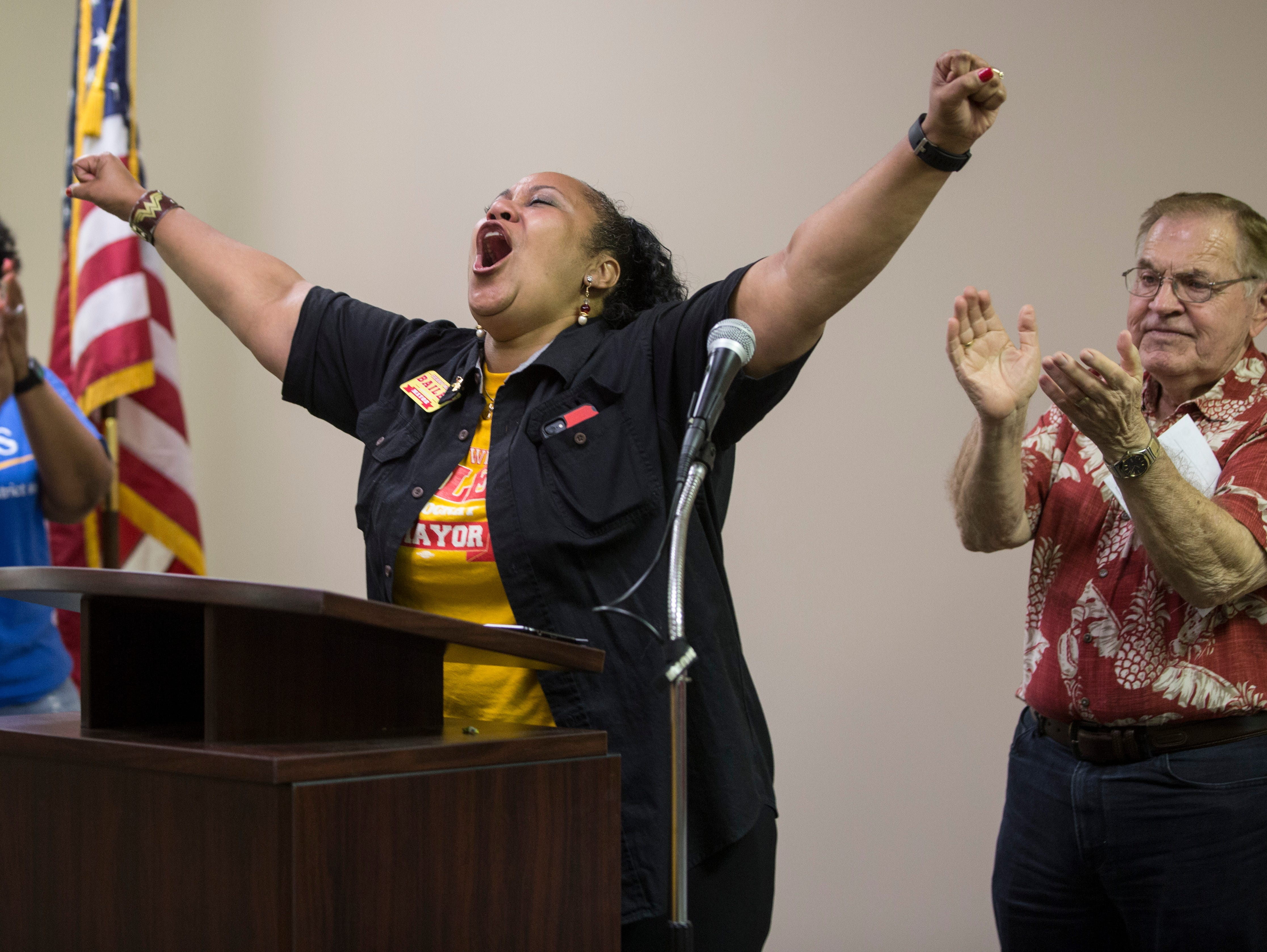 Terry Whitt Bailey gives out a cheer before beginning her victory speech at the Democratic Party's downtown headquarters on Tuesday night.