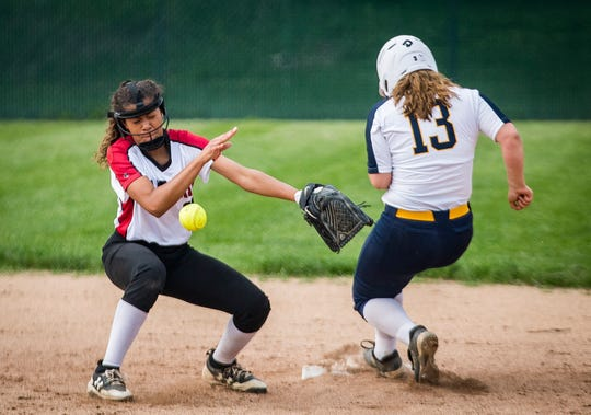 Wapahani's Alyvia Smith attempts an out at second against Delta during their championship game at Wes-Del High School Tuesday, May 7, 2019.