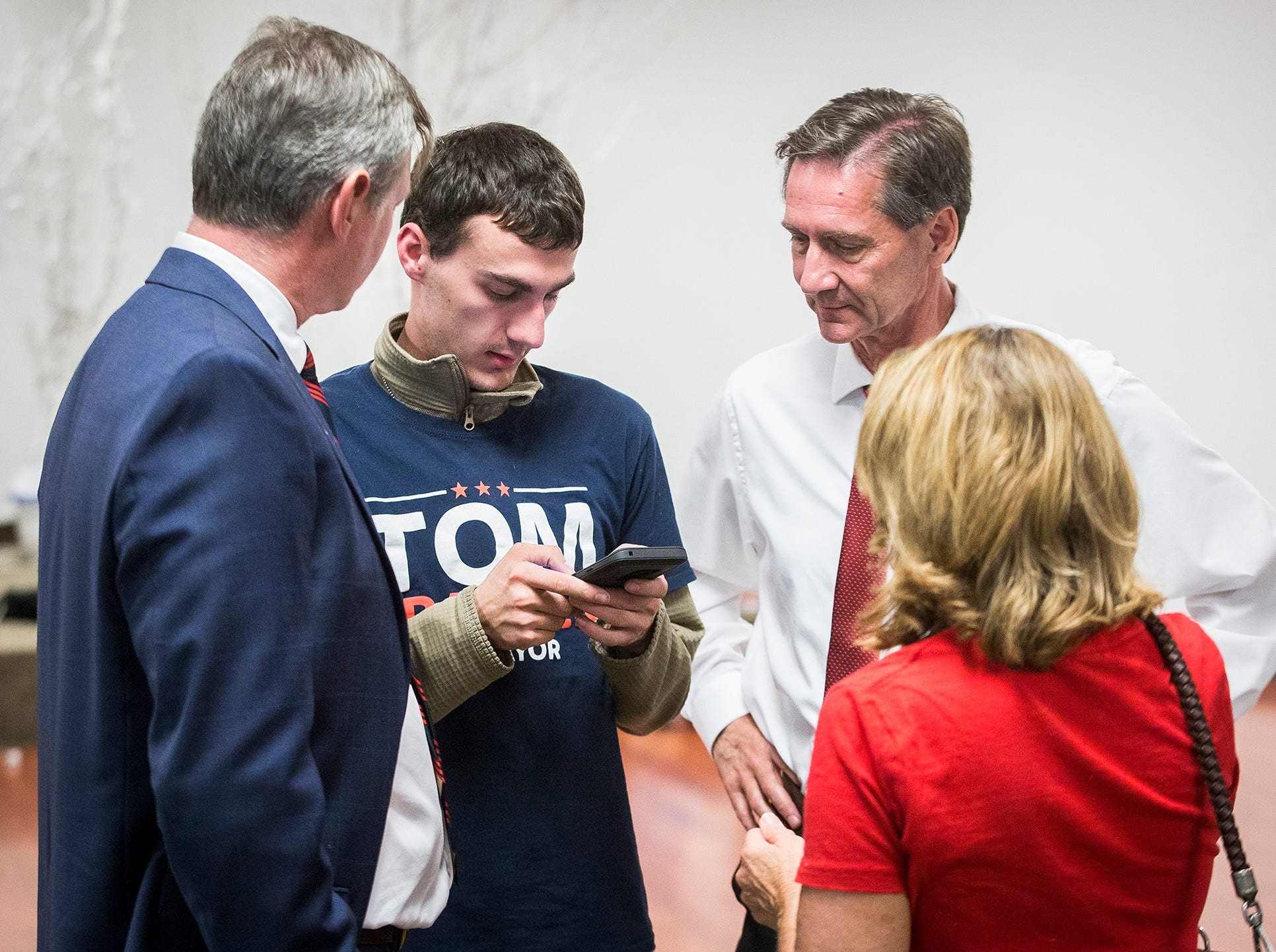 Tom Bracken and Dan Ridenour check election results at Knights of Columbus Tuesday night.