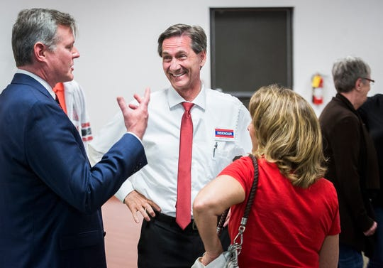 Republican mayoral nominee Dan Ridenour chats with Tom Bracken as elections results come in at Knights of Columbus in Muncie Tuesday.