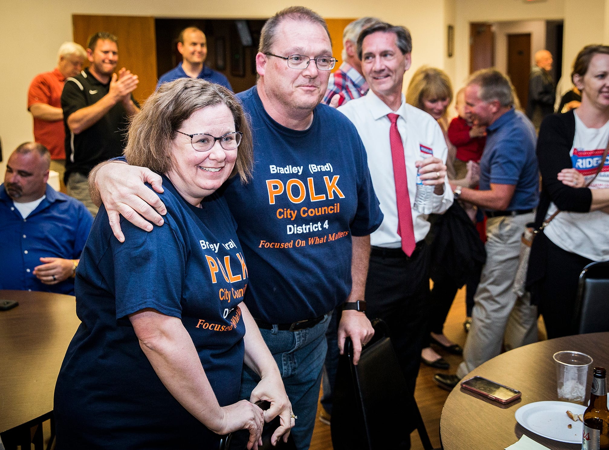 Republican city council nominee Bradley Polk celebrates with supporters at the Knights of Columbus Tuesday night.