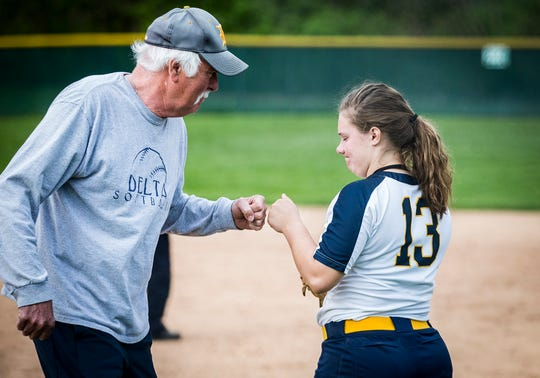 Delta's Natasha Coy fist bumps with head coach Doug Wilder during their championship game at Wes-Del High School Tuesday, May 7, 2019.