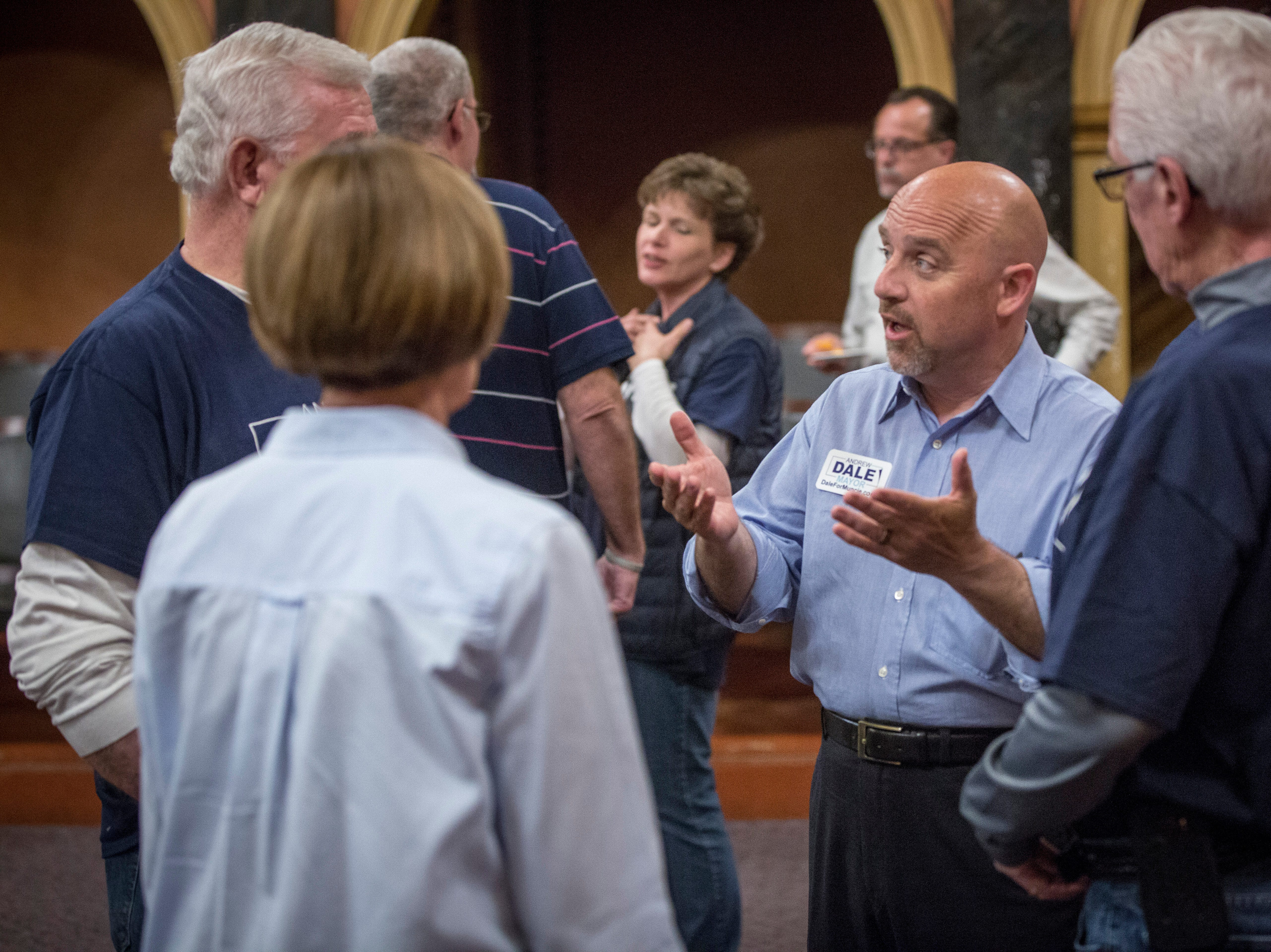 Andrew Dale talks with campaign staff and supporters before the election results came in. Dale lost the Democratic nomination for mayor by 256 votes.