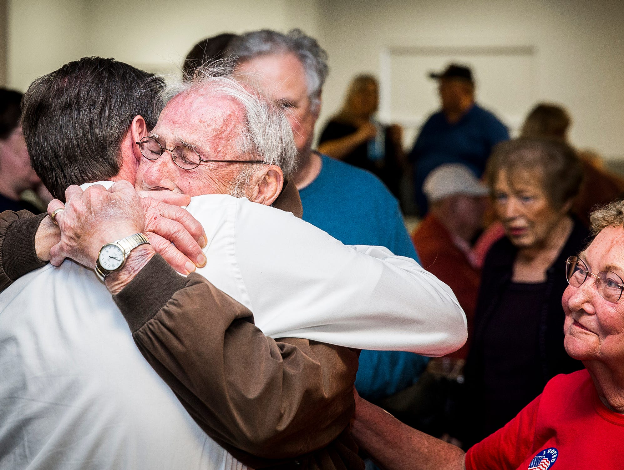 Republican mayoral nominee Dan Ridenour is congratulated by his parents at the Knights of Columbus Tuesday night.