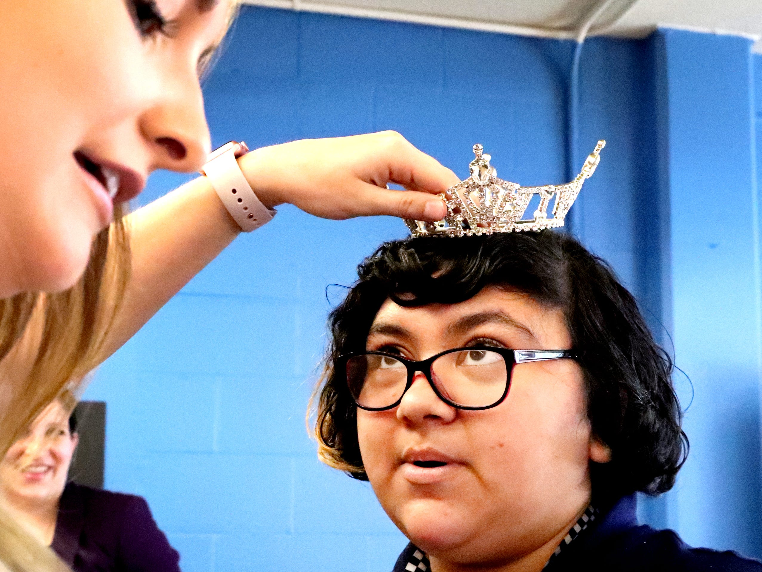 Miss Williamson County 2019 Savannah Rogers puts her crown Mariah M. Hulse, on one of the students in the Certified Pharmacy Technician program at the Tennessee Rehabilitation Center, during a CVS/TRC-Smyrna Mock Store Grand Opening Ceremony on Wednesday, May 8, 2019.