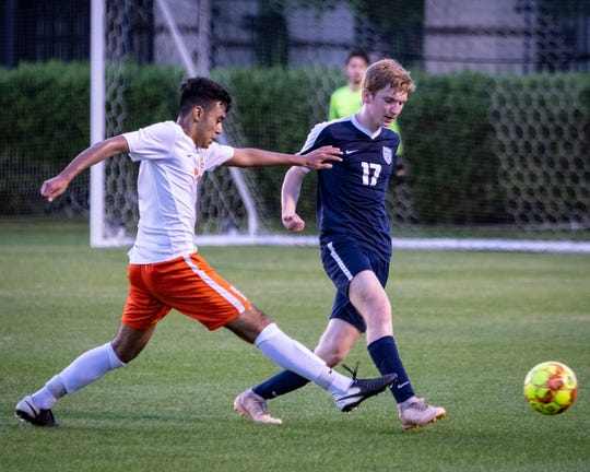 Blackman's Javier Martinez and Siegel's Eric Vaughan battle for the ball during Tuesday's 7-AAA soccer semifinals.