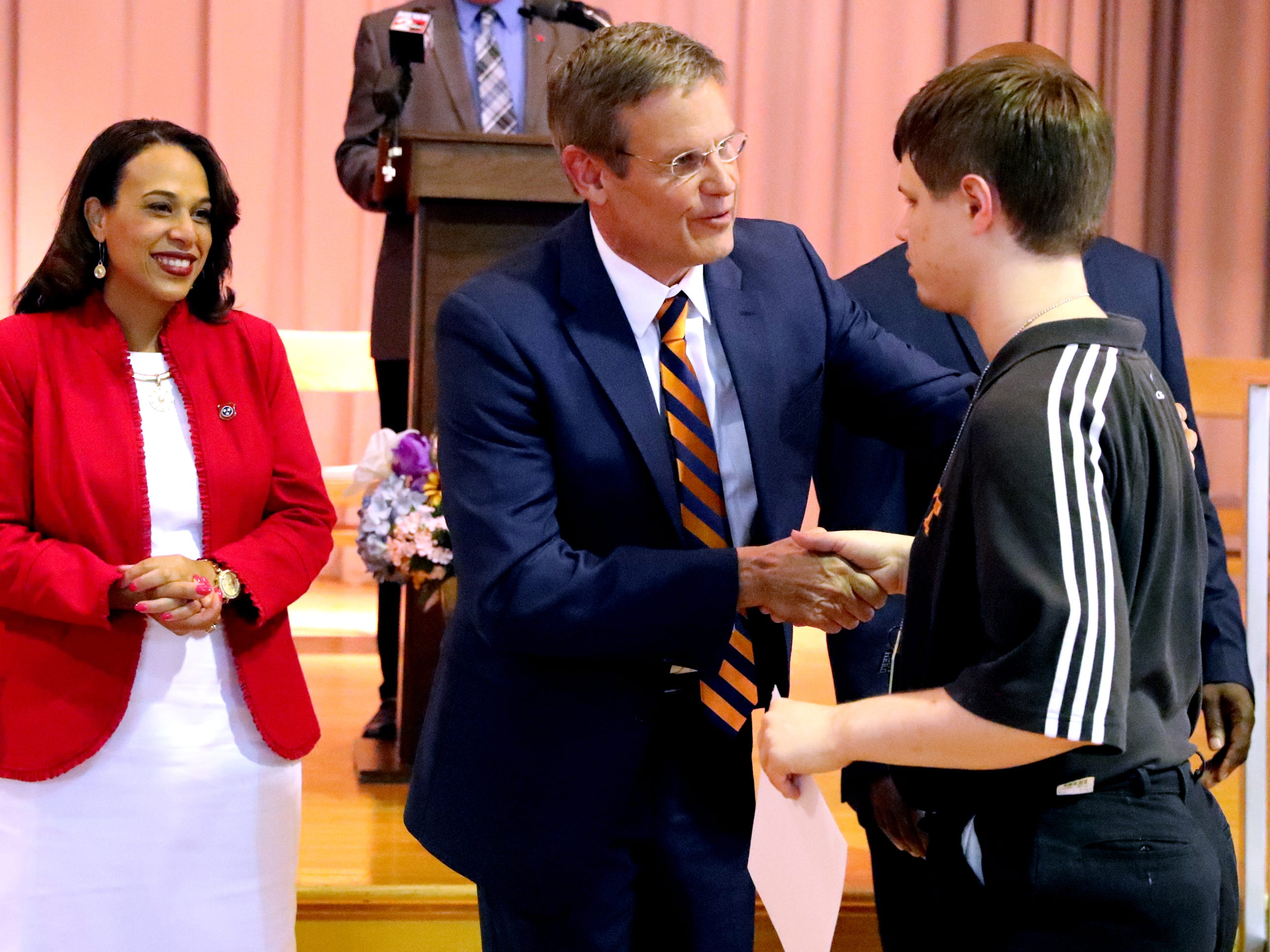 Tennessee Governor Bill Lee greats Christian Osborne, one of the students in the Certified Pharmacy Technician program at the Tennessee Rehabilitation Center, during a CVS/TRC-Smyrna Mock Store Grand Opening Ceremony on Wednesday, May 8, 2019, at the Tennessee Rehabilitation Center, in Smyrna.