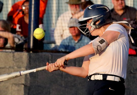 Blackman's Rachel Tarpley (14) makes contact with the ball during the game against Oakland on Tuesday, May 7, 2019, at Oakland, in Murfreesboro.