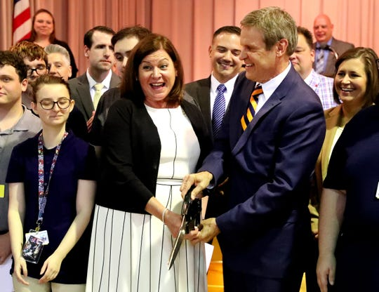 Lisa Bisaccia, Chief Human Resources Officer at CVS Health, left and Tennessee Governor Bill Lee cuts a ribbon during a CVS/TRC-Smyrna Mock Store Grand Opening Ceremony on Wednesday, May 8, 2019, at the Tennessee Rehabilitation Center, in Smyrna.