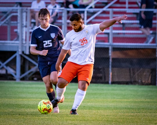 Blackman's Moe Khan (35) gets into a kick while Siegel's John Summar defends during Tuesday's 7-AAA soccer semifinals.