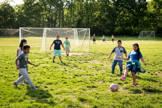 Children play soccer during a Path Project after-school program in the Franklin Estates neighborhood of Franklin, Tenn., Tuesday, May 7, 2019.
