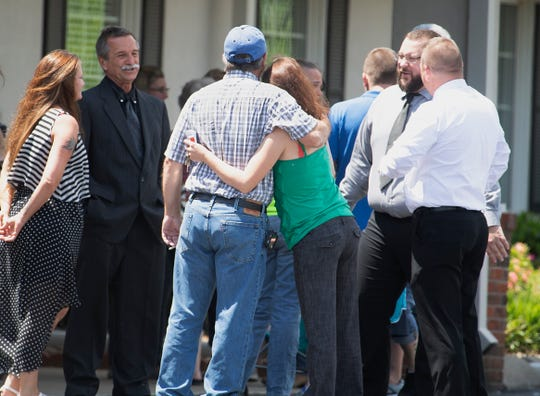 People gather outside Gilbert Funeral Home for funeral services for Clara Cummins, 44, David Cummins, 51, and Charles Hosale, 45, in Portland, Tenn. on Wednesday, May 8, 2019.