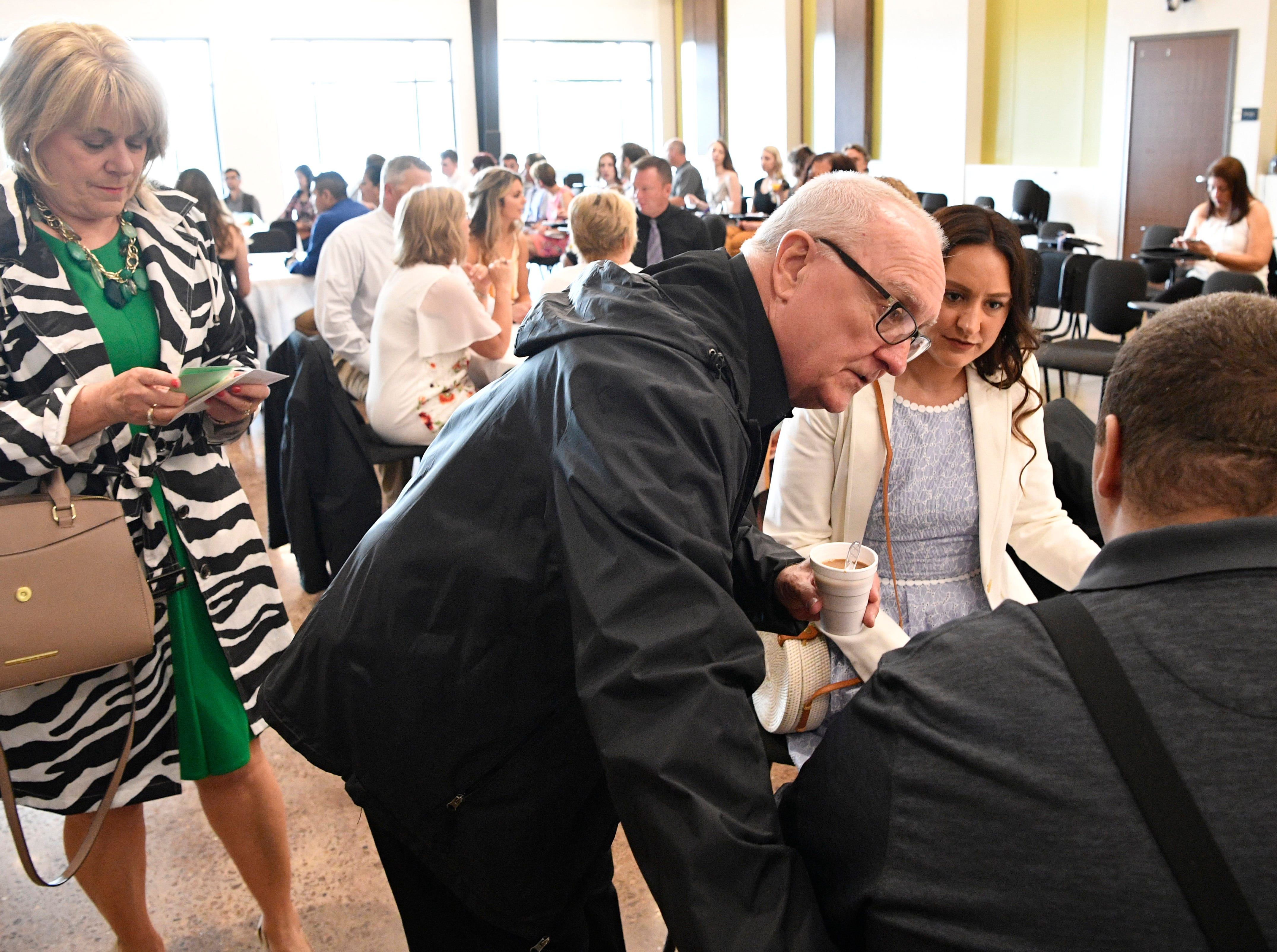 Brian Schnelle talks with his family before graduating from Trevecca on Saturday after 12 years as a student. He is on the autism spectrum & has pursued his degree for all those years, taking about 6 credits a semester Saturday, May 4, 2019, in Nashville, Tenn.