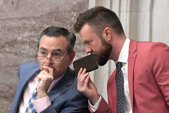Speaker Glen Casada, left, and his now-former chief of staff Cade Cothren speak during a session in Nashville on May 1.