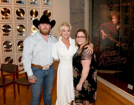 "Jessie Keith Whitley, Lorrie Morgan and Morgan Whitley attend Country Music Hall of Fame and Museum's new exhibit ""Still Rings True: The Enduring Voice of Keith Whitley"" at Country Music Hall of Fame and Museum on April 30, 2019 in Nashville, Tennessee."