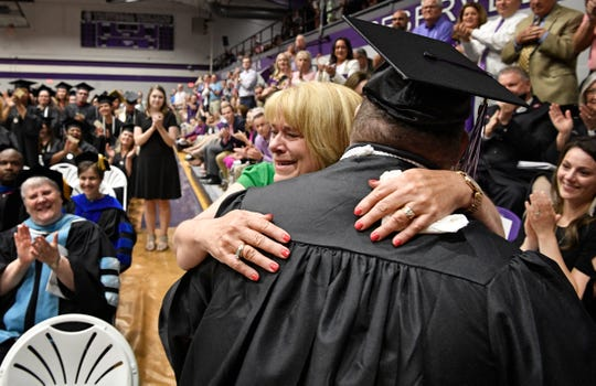 Brian Schnelle get a hug from his mother Jane before a standing ovation after he graduated from Trevecca on Saturday after 12 years as a student. He is on the autism spectrum & has pursued his degree taking about 6 credits a semester Saturday, May 4, 2019, in Nashville, Tenn.