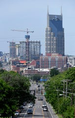 Construction cranes at Fifth and Broadway development can be seen in the Nashville skyline on Tuesday, May 7, 2019.