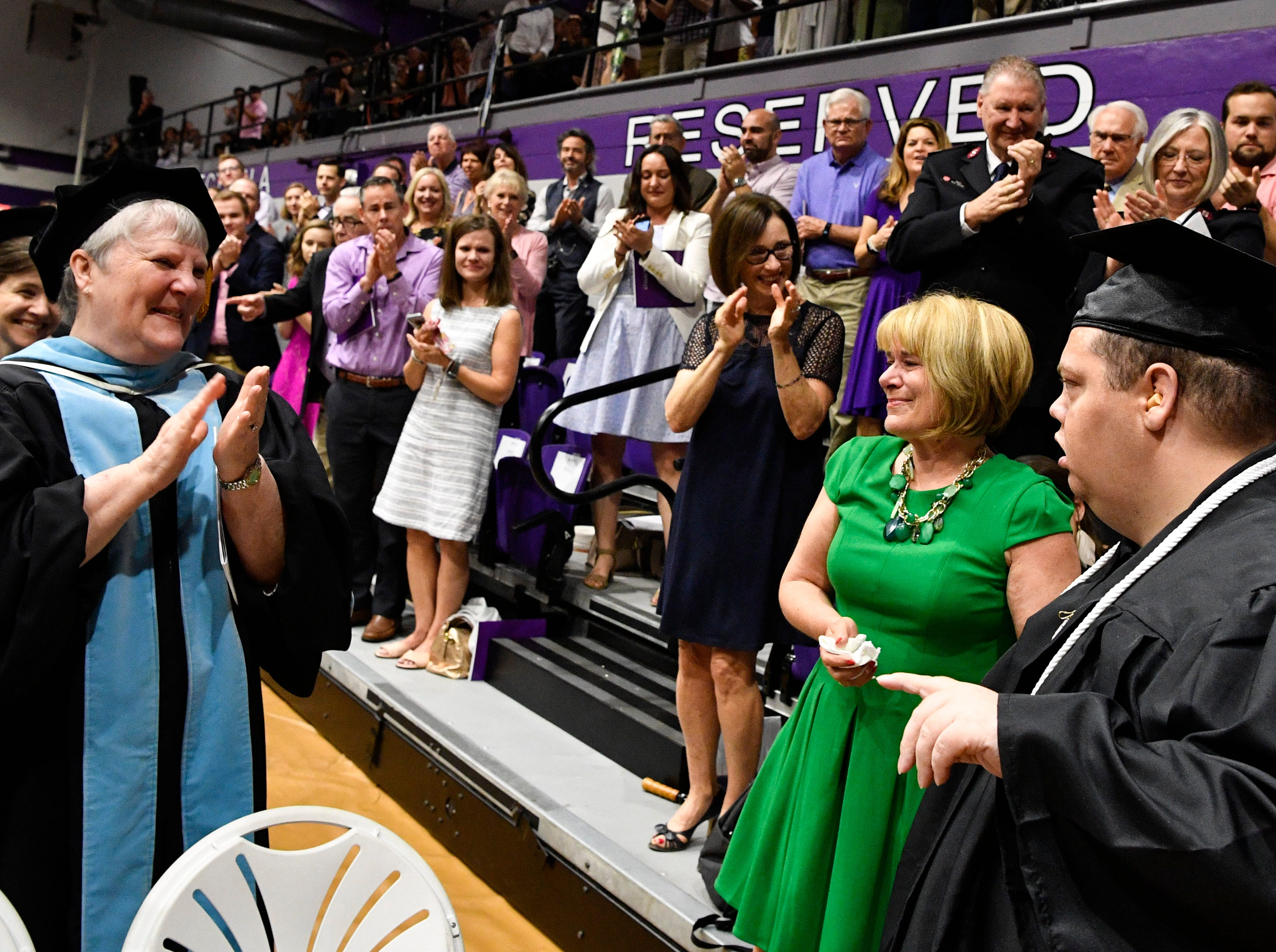 Standing with his mother Jane, Brian Schnelle receives a standing ovation from the crowd as he graduated from Trevecca on Saturday after 12 years as a student. He is on the autism spectrum & has pursued his degree taking about 6 credits a semester Saturday, May 4, 2019, in Nashville, Tenn.