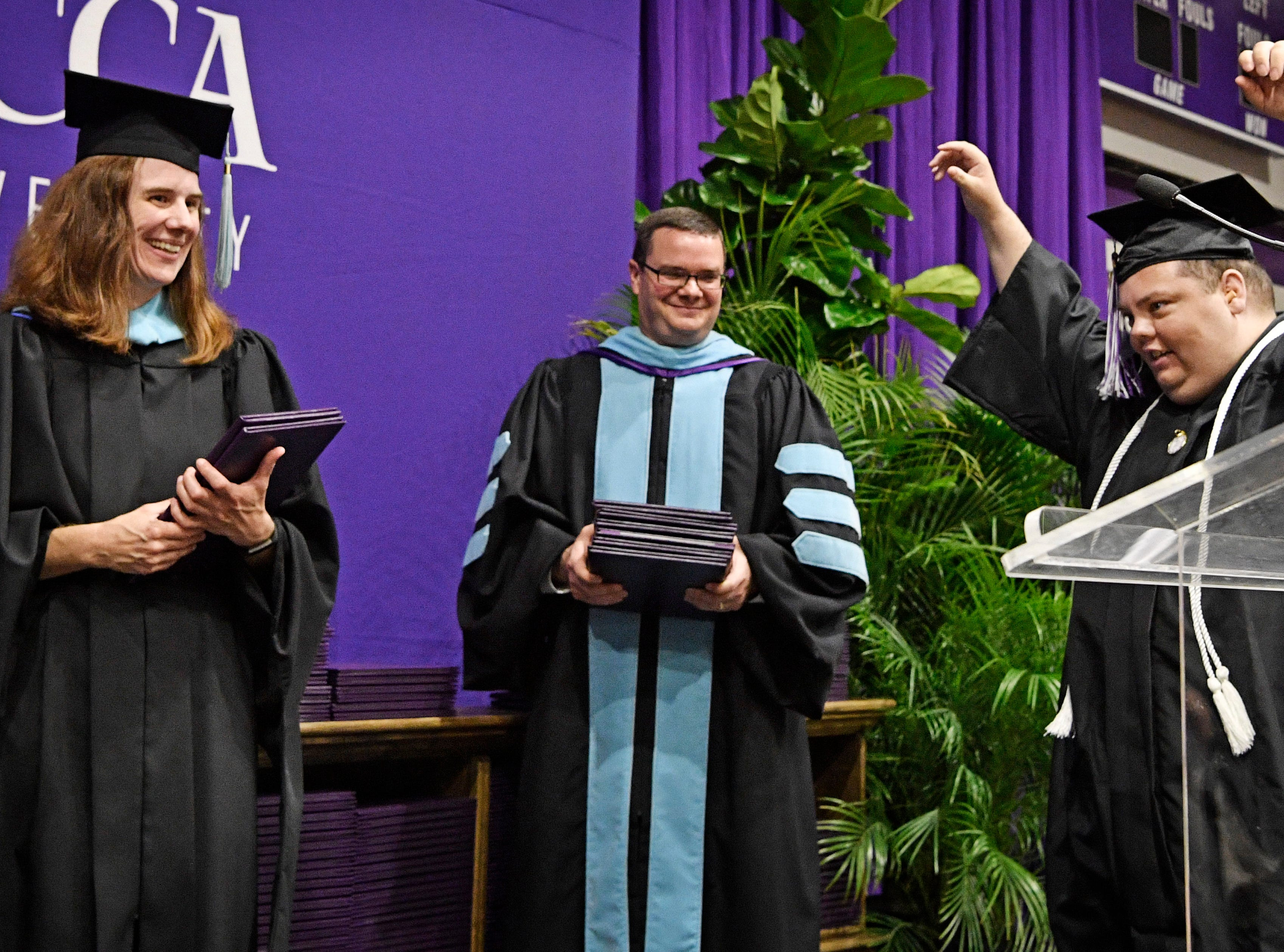 Brian Schnelle raises his arms in celebration as he graduated from Trevecca on Saturday after 12 years as a student. He is on the autism spectrum & has pursued his degree taking about 6 credits a semester Saturday, May 4, 2019, in Nashville, Tenn.