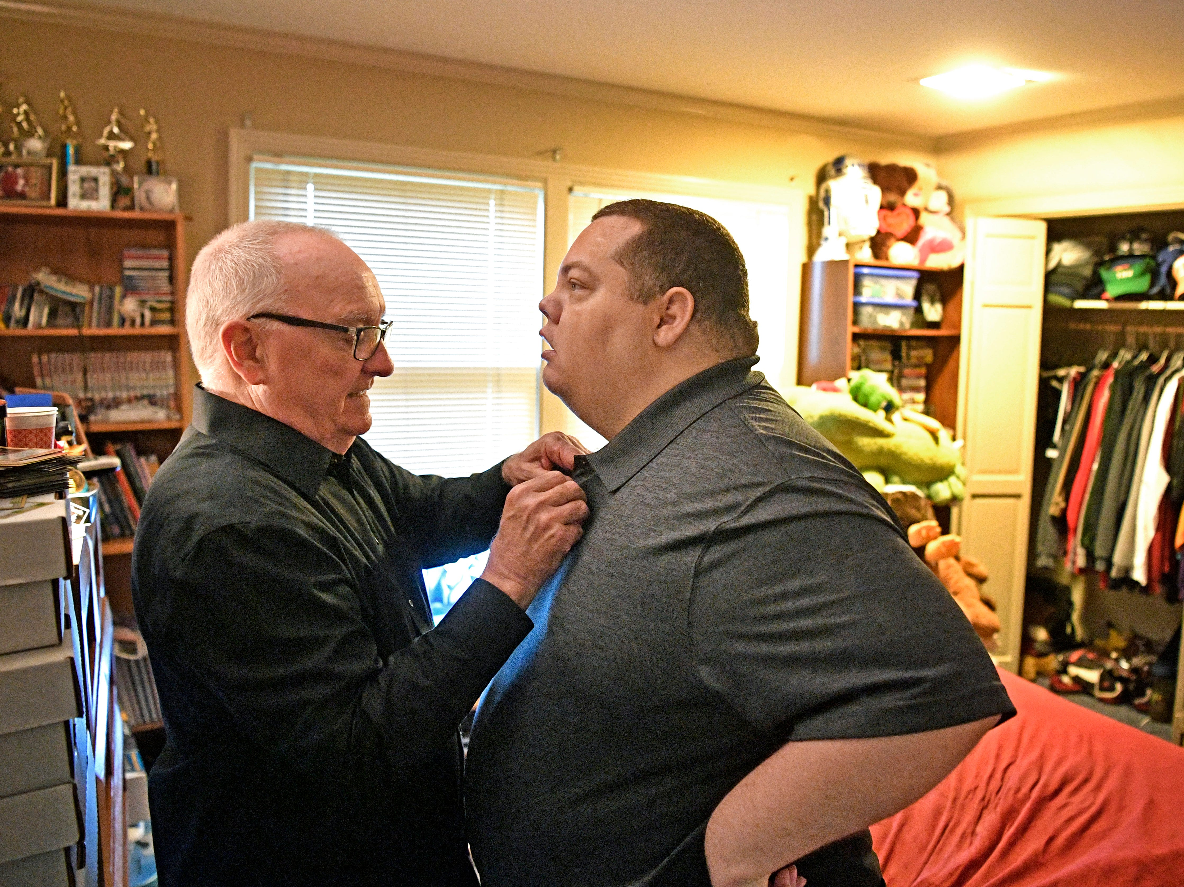 Jeff Schnelle helps get his son Brian ready for his big day. Brian graduated from Trevecca on Saturday after 12 years as a student. He is on the autism spectrum & has pursued his degree for all those years, taking about 6 credits a semester Saturday, May 4, 2019, in Nashville, Tenn.