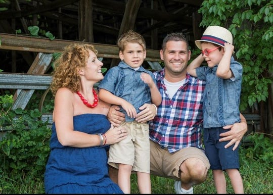 A 2014 family photo taken in Lebanon, Tenn., one week after Mollie Mills Sheppard, left, started chemo to treat her cancer. From left to right, Mollie, Tyler, Jason and Daxton Sheppard