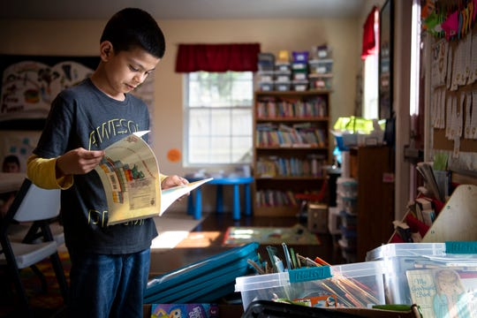 Johnny Ozziel Espinoza Peres, 9, picks out a book during a Path Project after-school program in the Franklin Estates neighborhood of Franklin, Tenn., Tuesday, May 7, 2019.