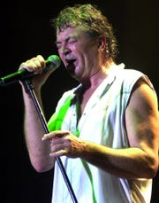 Vocalist Ian Gillan of Deep Purple sings during a 2002 concert in Bombay, India,