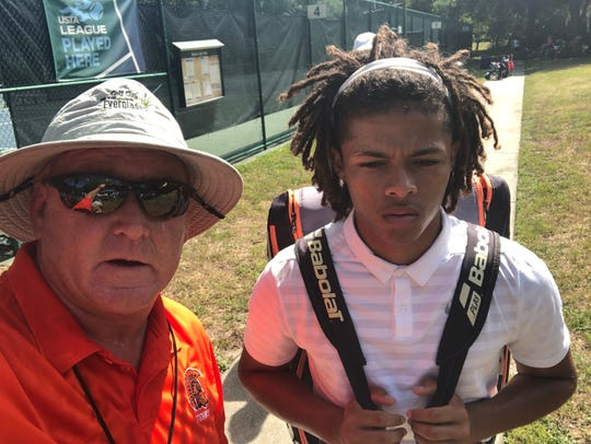 Lely tennis coach Kevin Smith and junior Diego Britt-Alvarez at the Class 2A state championships last week