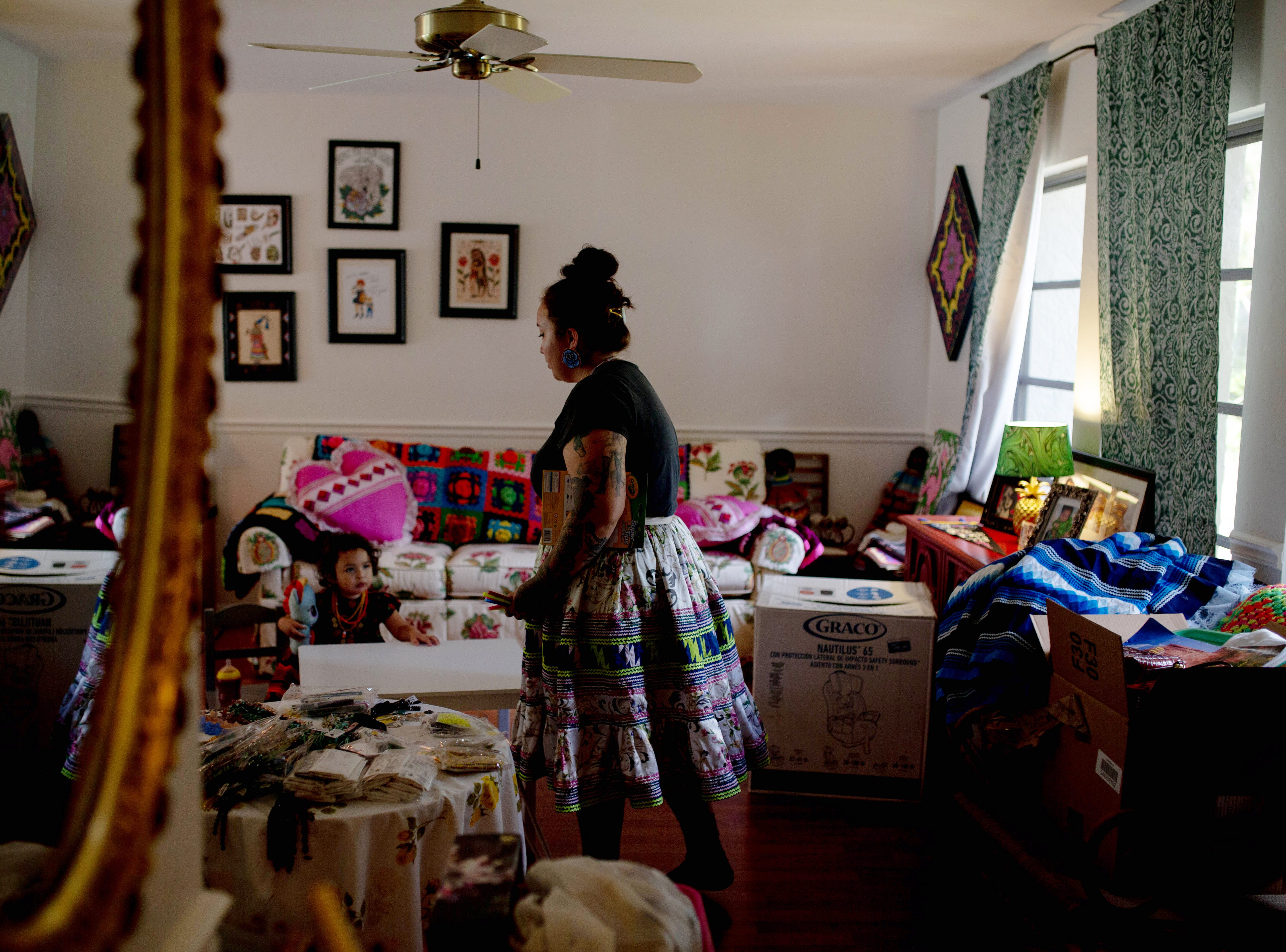 Dakota Osceola walks through her home in Naples on May 3, 2019. From the home, she makes the beadwork she sells to support herself and her daughter.