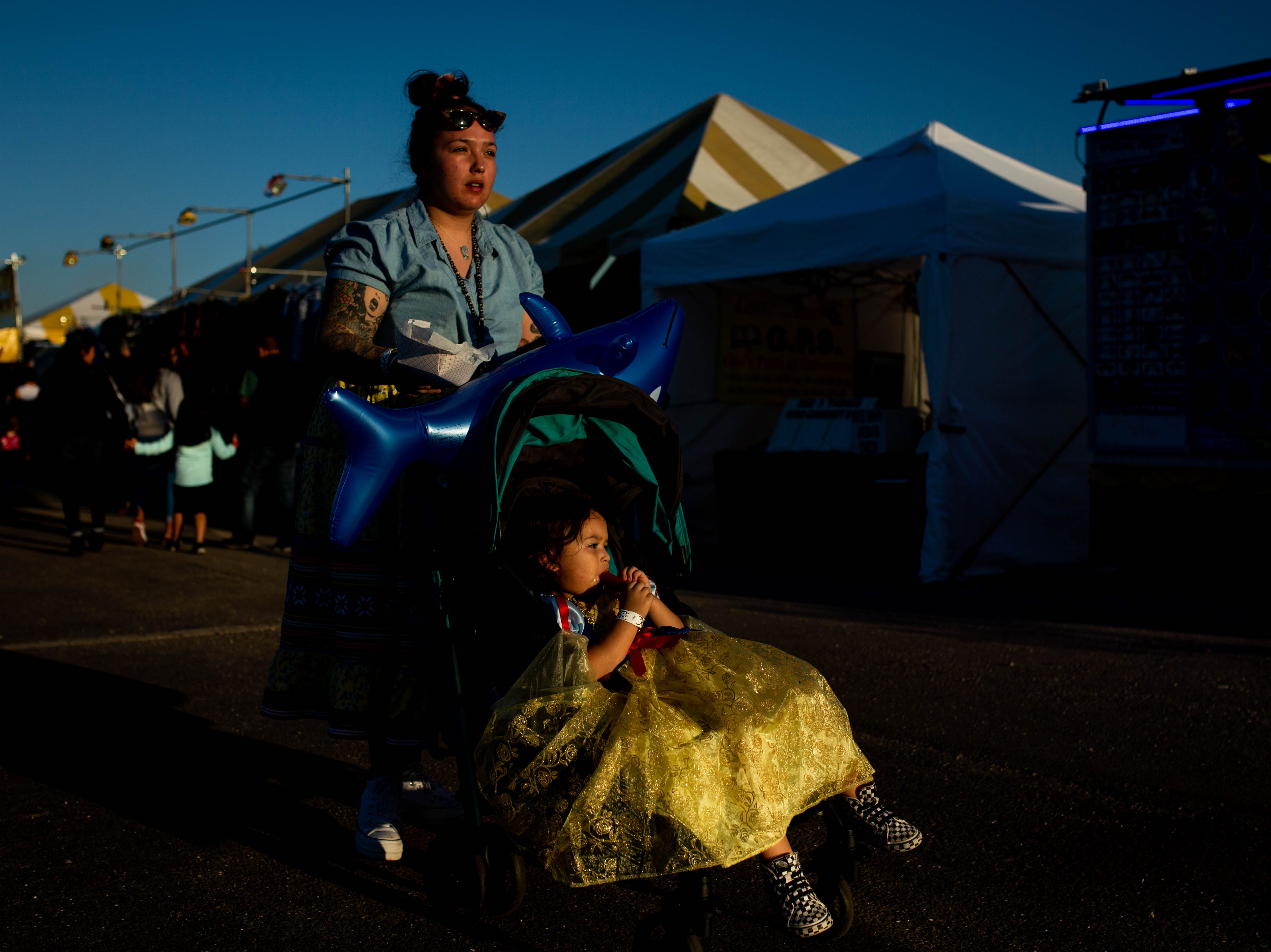 Dakota Osceola pushes her daughter Mia, 2, in a stroller at the Collier Fair in Naples on March 21, 2019. Since Mia's birth, Dakota has been a single mother, relying largely on the help of her family to raise her daughter.