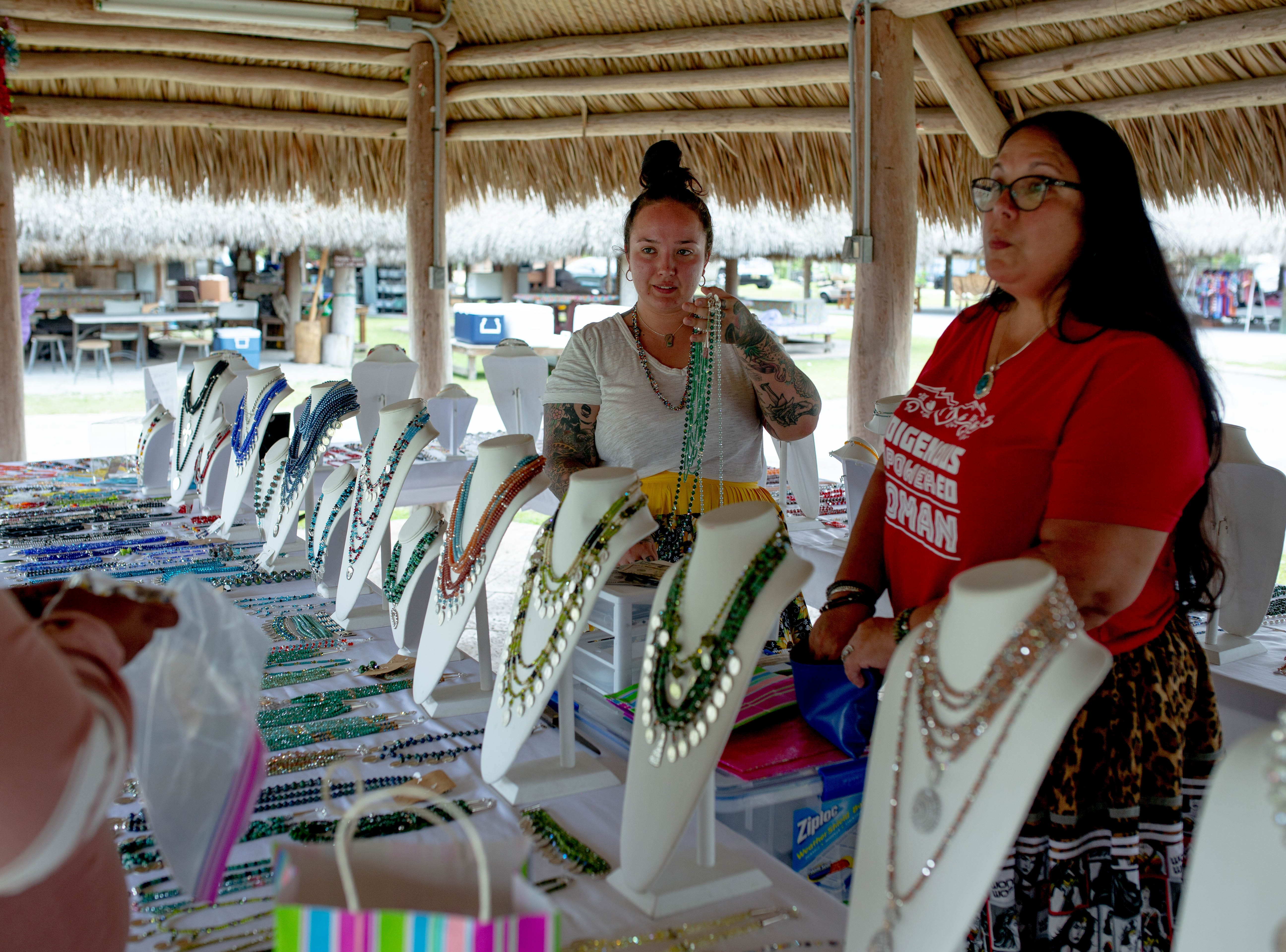 Dakota and Tina Osceola sell jewelry together at the Osceola Village on the Miccosukee Reservation on May 5, 2019. The mother and daughter make jewelry individually and often sell it together at events and locations across Southwest Florida.