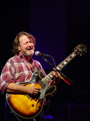 Widespread Panic's lead guitarist and vocalist John Bell performs a few years ago in Cincinnati. The band formed in Athens, Georgia, 33 years ago.