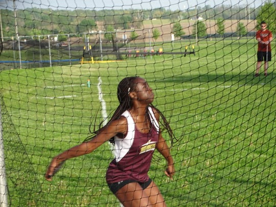 Licking Heights junior Kimitra Kusi competes in the discus May 7 during the Licking County League-Buckeye Division championships. She placed second in the event.