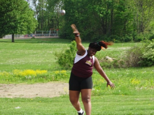Licking Heights freshman Denara Mbouge competes in the shot put May 7 during the Licking County League-Buckeye Division championships. She placed second in the event.